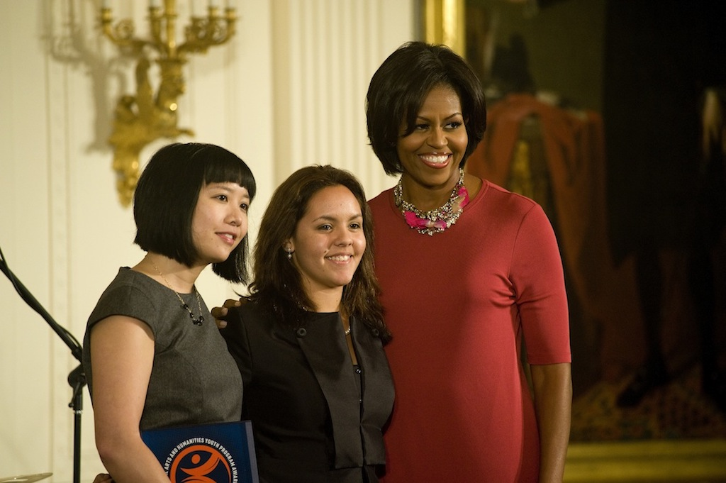 Representatives of WritersCorps, an Asian woman and a Latina teen, with First Lady Michelle Obama.