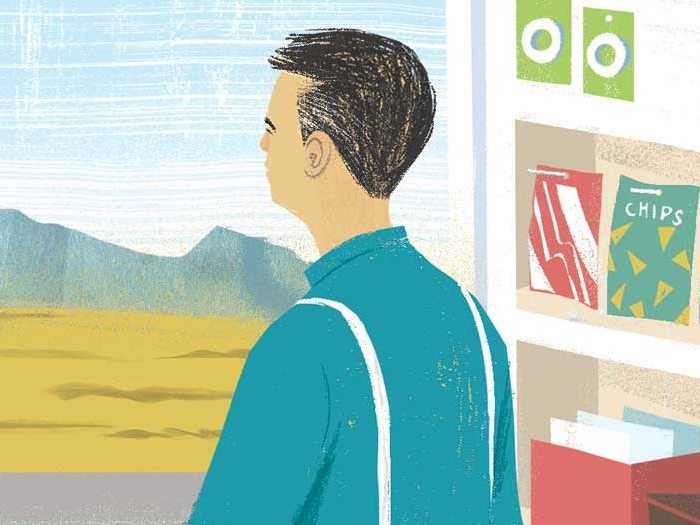 Illustartion of a storekeeper looking out a window at mountains. On the shelf next to him are bags of chips.