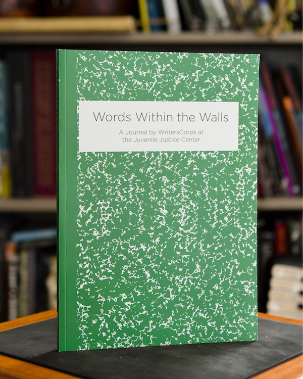 """Photo of a book standing up on a table. The book is like a scholastic notebook, but green, and the title says, """"Words Within the Walls"""""""