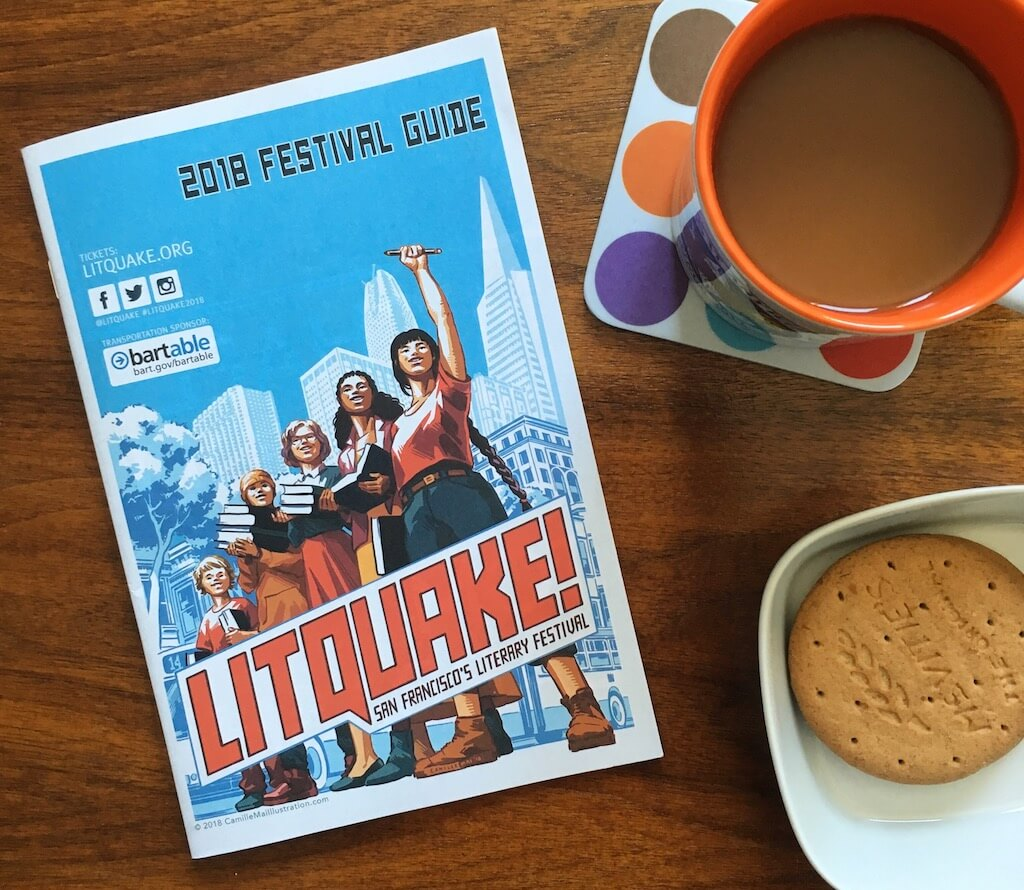 A program for Litquake 2018 next to a cup of coffee and a plate with a cookie. The cover of the guide has an illustration of 5 people, who appear to be women, with books