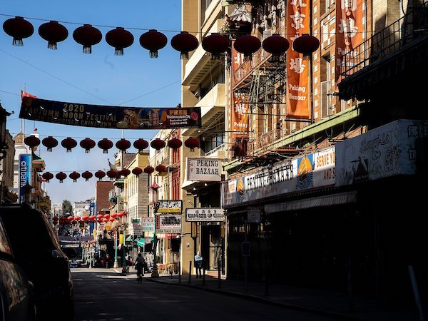 Photograph of lanterns strung across a street in San Francisco Chinatown
